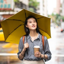 A woman walks with tea. Going without alcohol for the month of January can have many effects on your body, but your gut health can show serious changes.