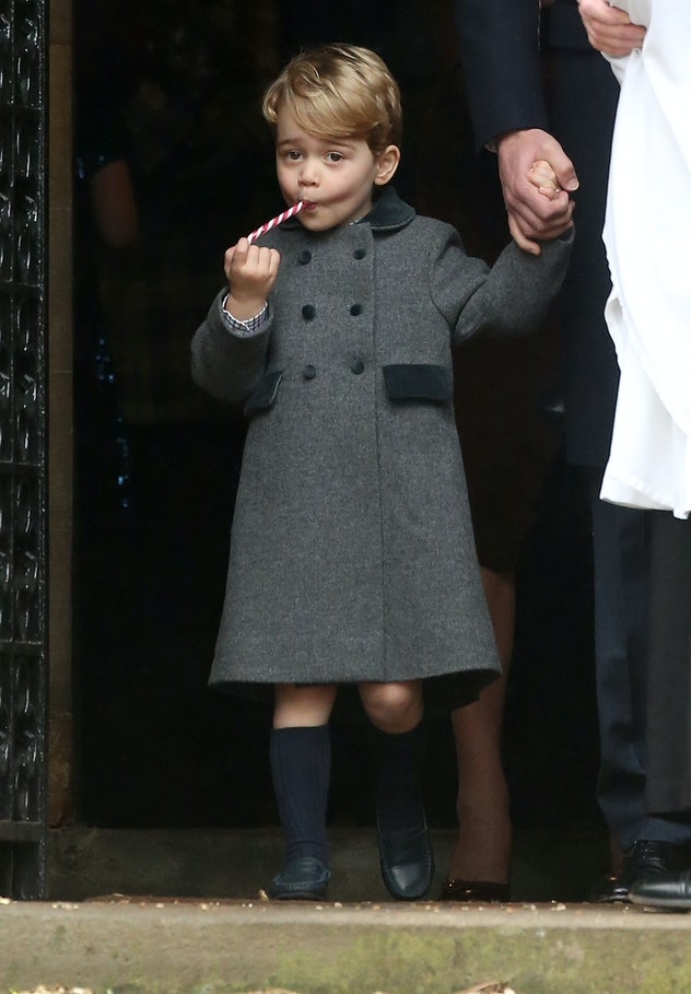 Prince George enjoys a candy cane after Christmas church services