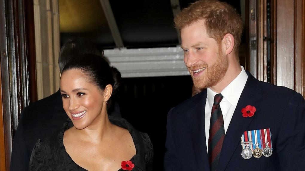 Meghan Markle and Prince Harry flash beaming smiles.