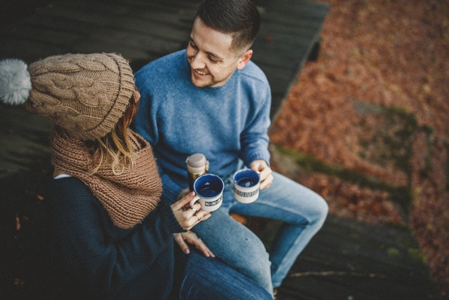 A couple drink tea in cold weather. Alcohol can impact the gut negatively, increasing intestinal permeability and symptoms of dysbiosis, according to experts.