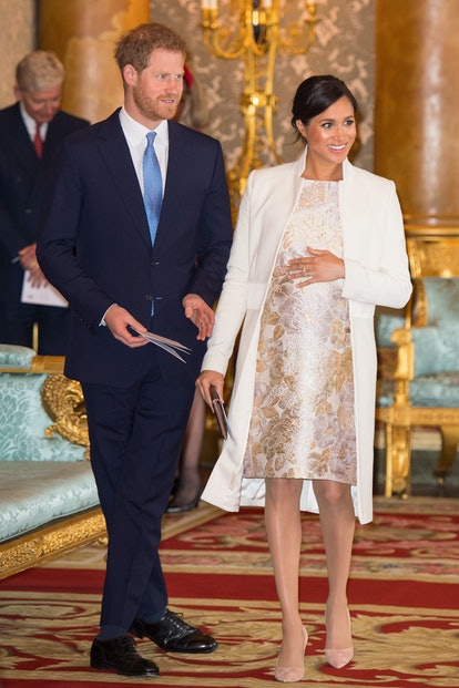 Meghan Markle's wore a brocade dress and Amanda Wakeley coat to celebrate Prince Charles.