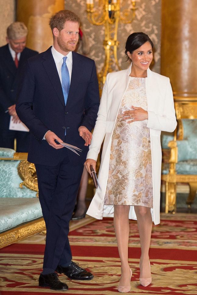 Meghan Markle's wore a brocade dress and Amanda Wakeley coat to celebrate Prince Charles.