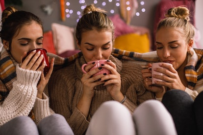Friends enjoy tea in January. Dry January can change your gut health in around three weeks, according to research.