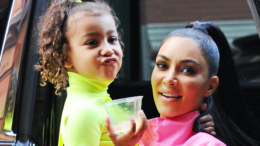 North West and Kim Kardashian step out in neon outfits.