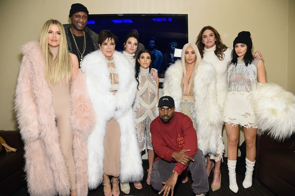 The Kardashian family attends a Kanye West concert.