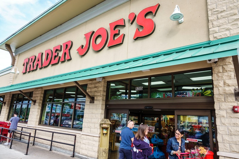 People enter and exit a Trader Joe's grocery store. Trader Joe's had recalled several pre-packaged f...