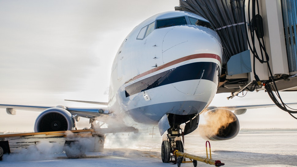 A plane sets up for a flight at a jetbridge. Carbon offsets are touted as a way to reduce the environmental impact of air travel, but they need to be taken in context.