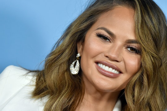 Chrissy Teigen clapped back at trolls who told her to cover up in front of Luna.
