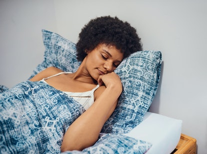 A woman sleeps. Nightmares don't just affect your heart rate; they also affect your autonomic nervous system, including your digestion and body temperature.