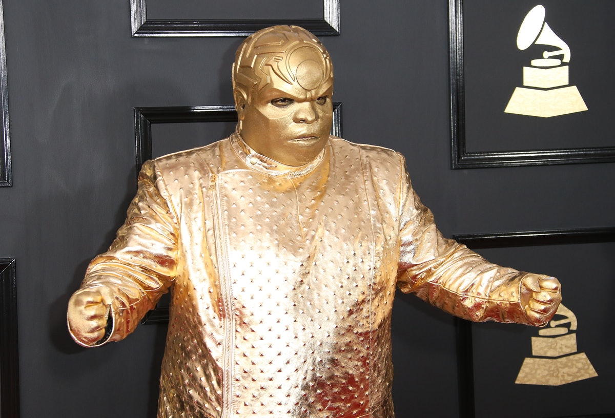 The tweets about Kanye painting himself silver compare him to CeeLo Green's 2017 Grammy Awards outfi...