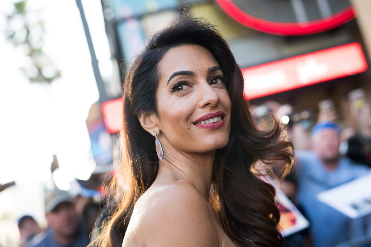 Amal Clooney's Gold Heels At Meghan Markle's Baby Shower Are Right In Line With The Duchess' Style