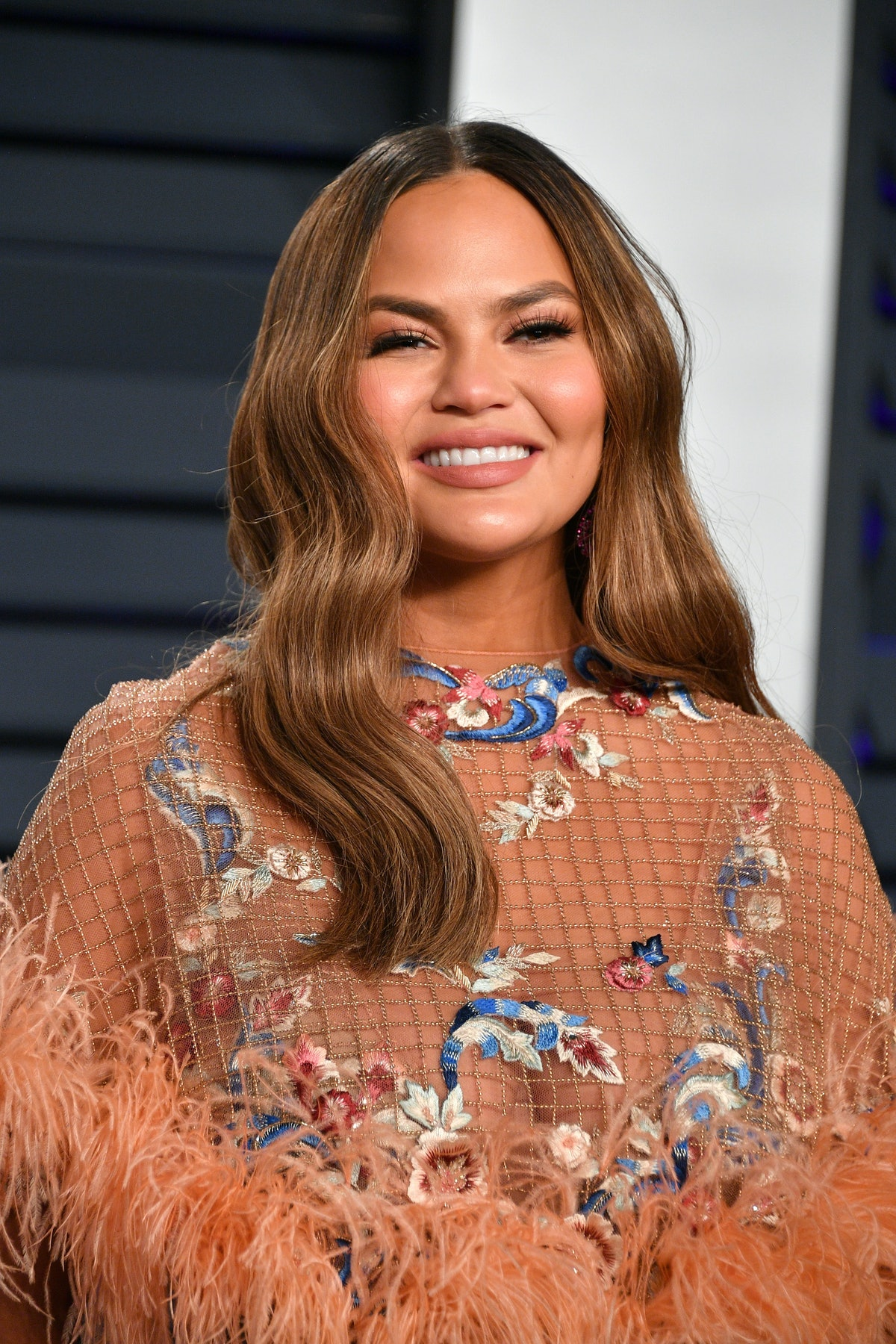 Chrissy Teigen's Bob & Bangs Looks Straight Out Of The '90s