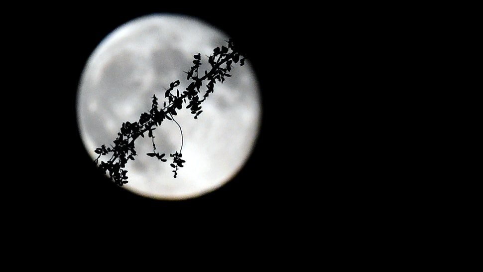 How The July 2019 Full Moon & Lunar Eclipse Will Affect You