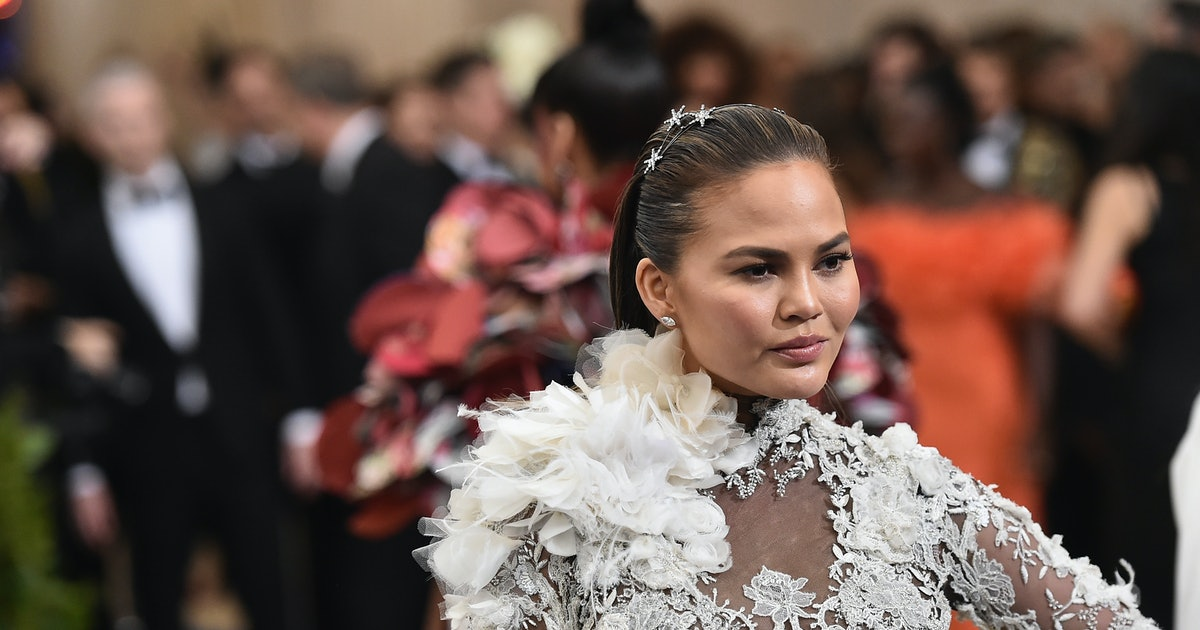Chrissy Teigen's Slouchy Boots Totally Deserve A Spot In Your Summer Shoe Lineup