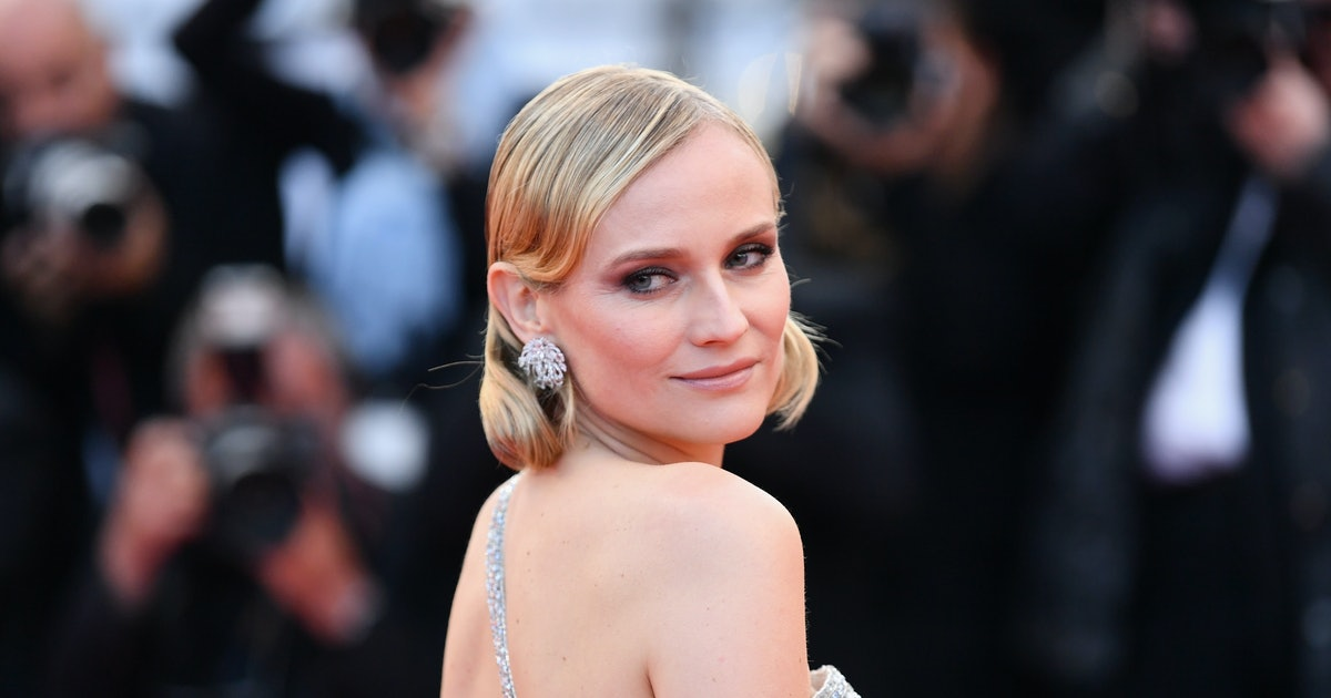 Diane Kruger's White Sneakers Make Her Suit Infinity Cooler