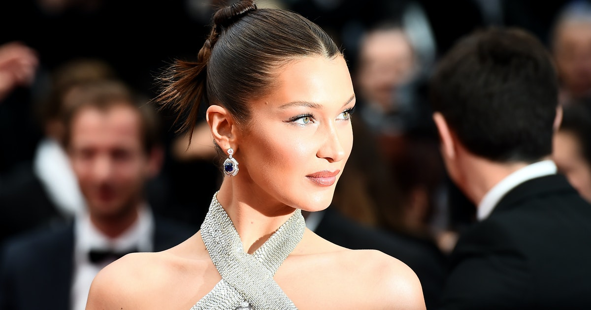 Bella Hadid's Black Knee-High Boots Are The Unexpected Summer Accessory You Didn't Know You Needed