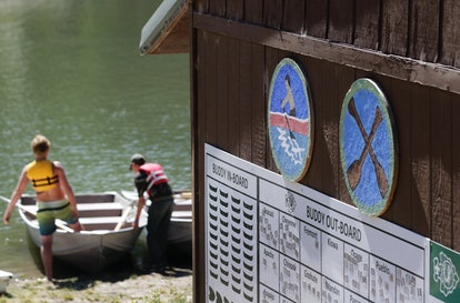 PAYSON, UT - JULY 31: Two Boy Scout get in a row boat on a lake at camp Maple Dell on July 31, 2015 ...