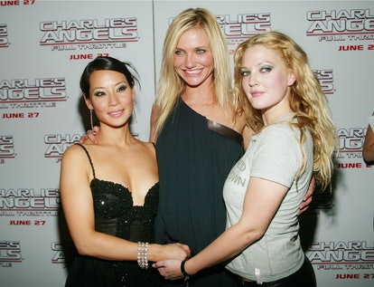 "NEW YORK - JUNE 25: (U.S. TABS AND HOLLYWOOD REPORTER OUT) Co-stars Luct Liu, Cameron Diaz and Drew Barrymore arrive at Columbia Pictures' Special Screening of ""Charlie's Angels: Full Throttle"" at Loews Lincoln Square June 25, 2003 in New York City. (Photo by Evan Agostini/Getty Images)"