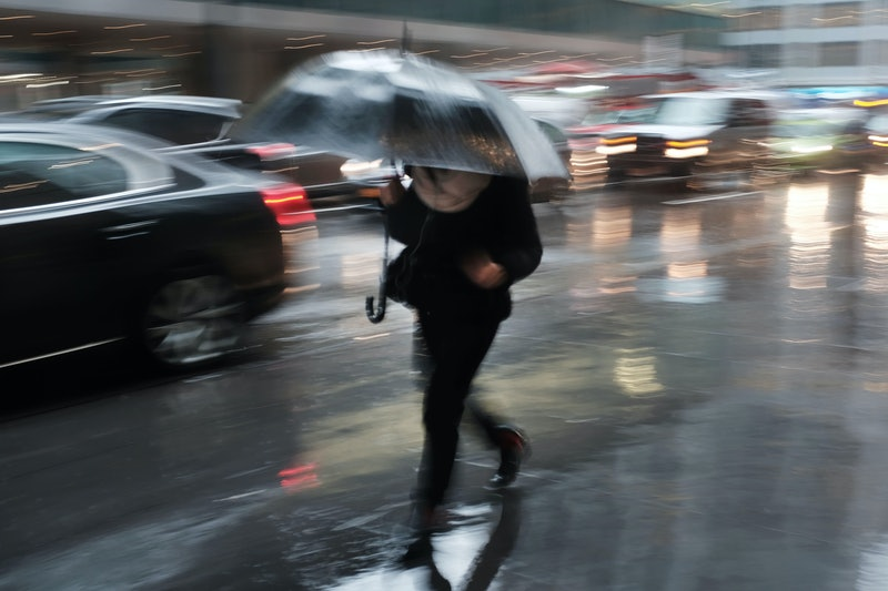 NEW YORK, NEW YORK - JANUARY 24: Pedestrians walk through a heavy late morning rain on January 24, 2019 in New York City. A flood watch has been issued for New York City as forecasts call for heavy rain throughout the day. So far this winter New York City, and much of the Northeast, has received little snowfall.  (Photo by Spencer Platt/Getty Images)