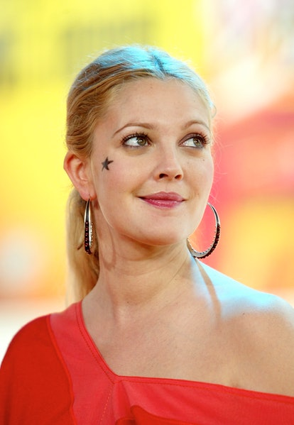 NEW YORK - JUNE 26: (U.S. TABS OUT) Drew Barrymore on stage during MTV's Total Request Live June 26, 2003 at the MTV Times Square Studios in New York City. (Photo by Scott Gries/Getty Images)