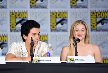 """SAN DIEGO, CA - JULY 22:  Cole Sprouse (L) and Lili Reinhart attend """"Riverdale"""" special video presentation and Q+A during Comic-Con International 2017 at San Diego Convention Center on July 22, 2017 in San Diego, California.  (Photo by Mike Coppola/Getty Images)"""