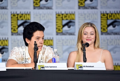 "SAN DIEGO, CA - JULY 22:  Cole Sprouse (L) and Lili Reinhart attend ""Riverdale"" special video presentation and Q+A during Comic-Con International 2017 at San Diego Convention Center on July 22, 2017 in San Diego, California.  (Photo by Mike Coppola/Getty Images)"