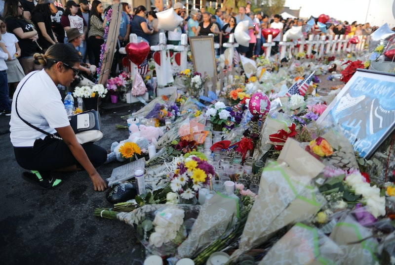 EL PASO, TEXAS - AUGUST 06: People gather at a makeshift memorial honoring victims outside Walmart, near the scene of a mass shooting which left at least 22 people dead, on August 6, 2019 in El Paso, Texas.  A 21-year-old white male suspect remains in custody in El Paso, which sits along the U.S.-Mexico border. President Donald Trump plans to visit the city August 7.  (Photo by Mario Tama/Getty Images)