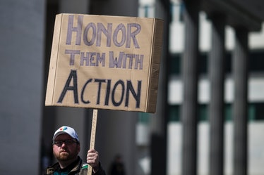 WASHINGTON, DC - MARCH 24: A demonstrator holds a sign the March for Our Lives rally March 24, 2018 ...