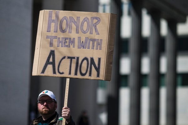 WASHINGTON, DC - MARCH 24: A demonstrator holds a sign the March for Our Lives rally March 24, 2018 in Washington, DC. Hundreds of thousands of demonstrators, including students, teachers, and parents are expected to gather for the anti-gun violence rally, spurred largely by the shooting that took place on February 14 at Marjory Stoneman Douglas High School in Parkland, Florida where 17 people died.  (Photo by Zach Gibson/Getty Images)