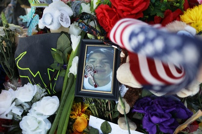 EL PASO, TEXAS - AUGUST 07: A photo of victim Javier Amir Rodriguez, a 15-year-old sophomore, rests on flowers at a makeshift memorial honoring victims outside Walmart, near the scene of a mass shooting which left at least 22 people dead, on August 7, 2019 in El Paso, Texas. A 21-year-old white male suspect remains in custody in El Paso which sits along the U.S.-Mexico border. President Donald Trump plans to visit the city later today. (Photo by Mario Tama/Getty Images)