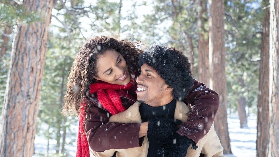 A couple play in snow. Winter may represent a downturn in libido for many people because of various factors, experts say.