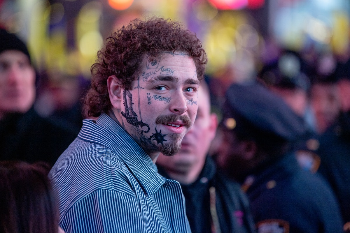 Post Malone's new face tattoo for 2020 is a medieval gauntlet holding a flail