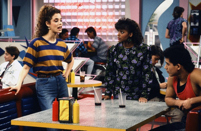 Elizabeth Berkley (Jessie), Mario Lopez (Slater), and Lark Voorhees (Lisa) hang out at The Max in a still from the original 'Saved by the Bell.'