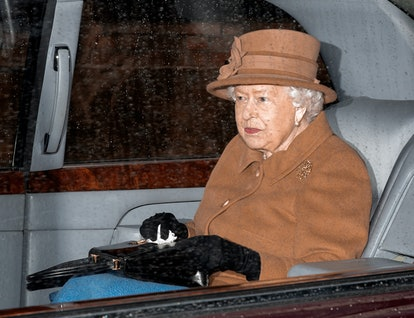The Queen's brown coat and hat are similar to Markle's look when she visited Canada House.