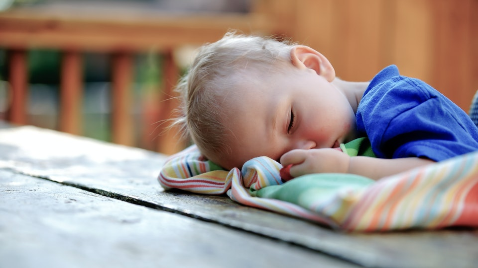 toddler sleeping with head on table