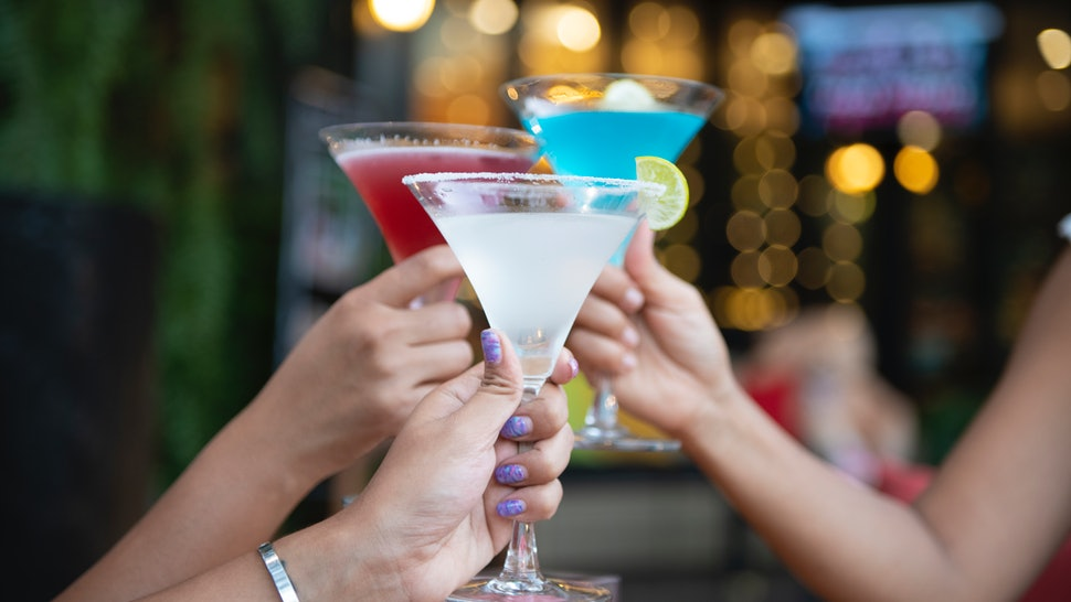 Three women toast martinis. Alcohol-related deaths are on the rise for women and other minority genders.