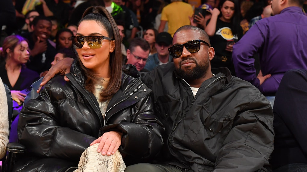 Kim Kardashian and Kanye West attend a Lakers game.