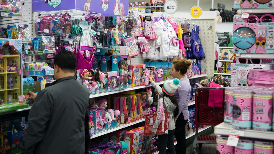 people shopping in the toy section of target