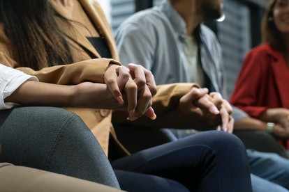 A group of people attend a group therapy session. If individual talk therapy isn't working for you, another method of therapy might be the solution.