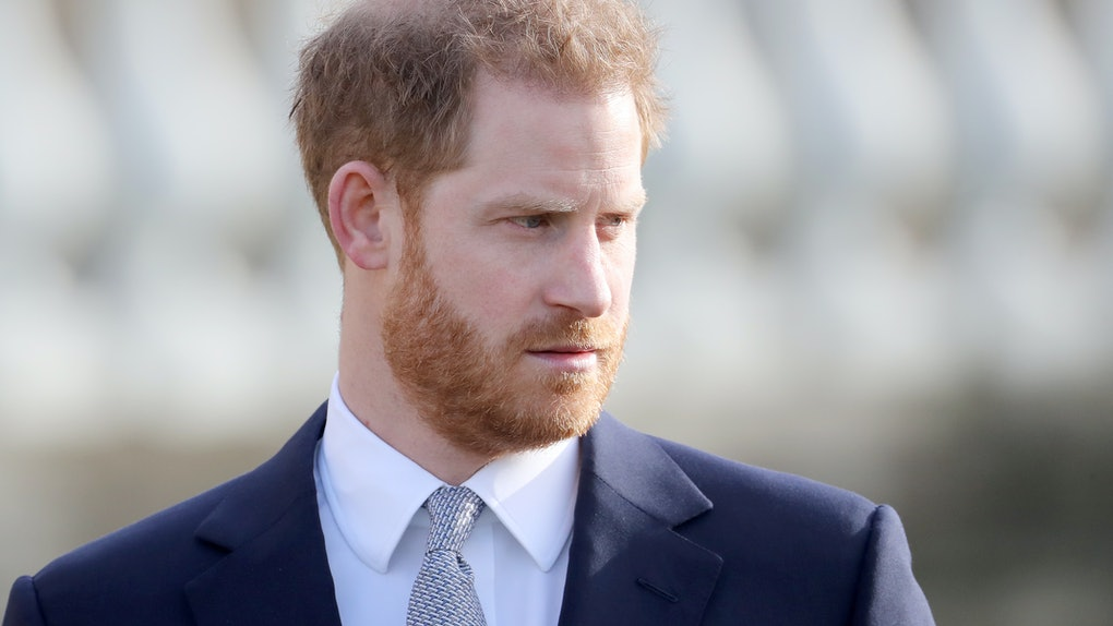Prince Harry steps out in a navy blue suit.