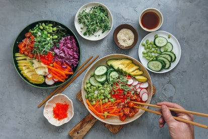 A person tucks into a plate of food. Intermittent fasting may have some benefits for digestion but can also lead to feelings of starvation that can cause irritability and worsen mental health.