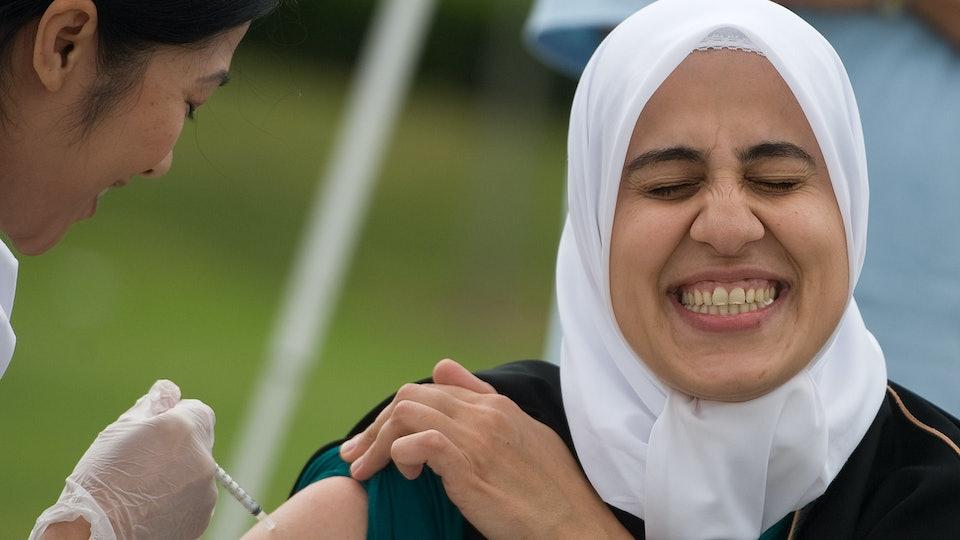 a woman getting her flu shot