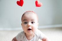 baby wearing a valentine's day headband