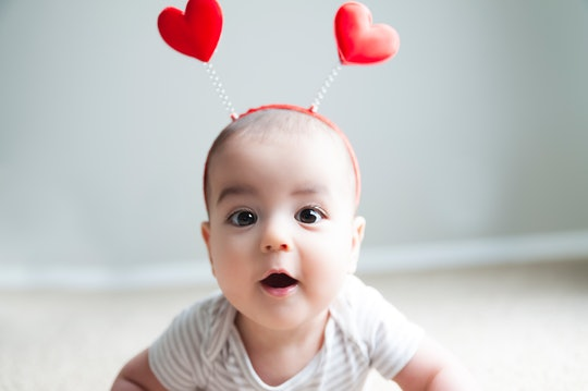 baby wearing a valentine's day headband
