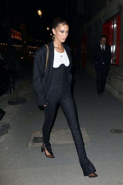 Bella Hadid's '90s updo and Fenty ensemble.