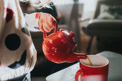 A hand pours tea. Our habit of repeating tasks can give insight into intrusive thoughts and repetitive behaviors.
