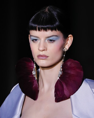 Baby bangs trend seen at Valentino Spring 2020 Couture show.