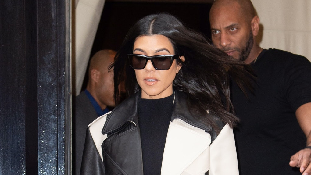 Kourtney Kardashian steps out in a black and white jacket.