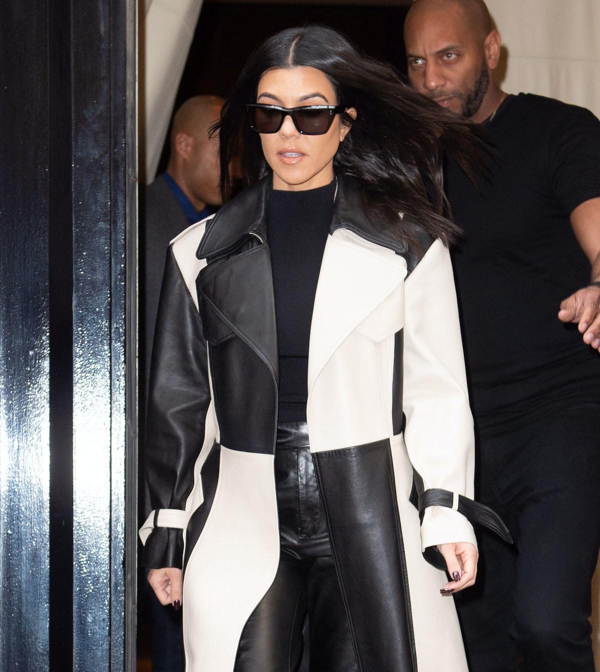 Kourtney Kardashian steps out in a black and white jacket.