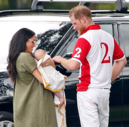 Meghan Markle and Prince Harry fuss over baby Archie.